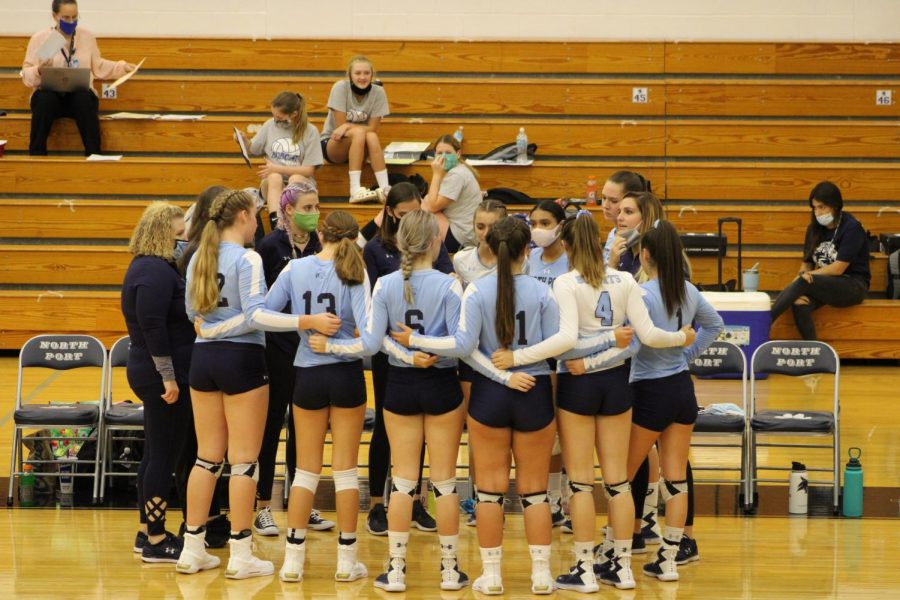 "Huddle up! The North Port Bobcats take a break to talk things over. North Port would later go on to beat Palmetto high 3-1. Caitlyn St. Germain stated, ""We use these games to practice our plays while playing mediocre teams like Palmetto."""