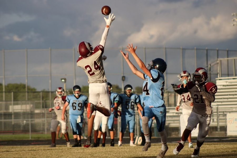 A pass from North Port doesn't seem to get over the fingertips of a Riverview defender.
