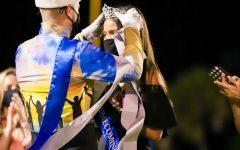 4-time winning Homecoming King, Logan King, crowns the Homecoming Queen, Asia Blaszak.