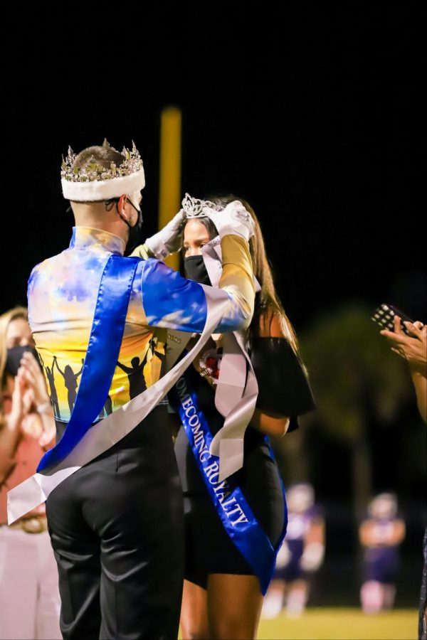 4-time winning Homecoming King, Logan King, crowns the Homecoming Queen, Asia Blaszak.