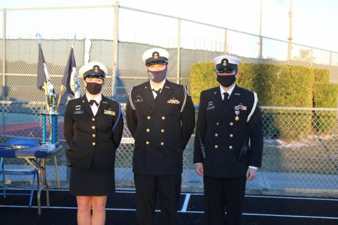 3 Members of the NJROTC in dress uniform standing at attention