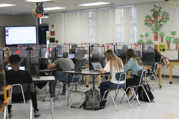 Mrs. David's Environmental Science Classroom with students working at desks.
