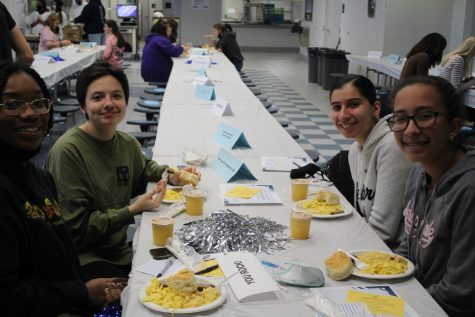 students smile over breakfast in the cafeteria