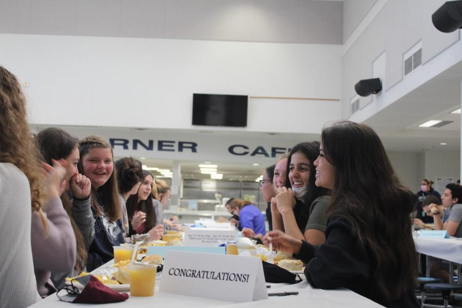 Students eating breakfast in the cafeteria
