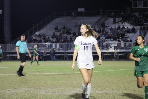North Port Girls soccer team player walking towards the left side of the picture proudly