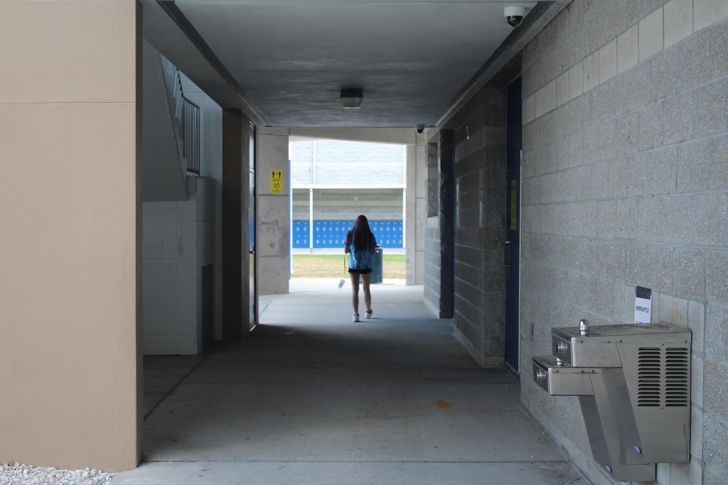 View of the hallway near the ISR room, with a student walking down the hall.