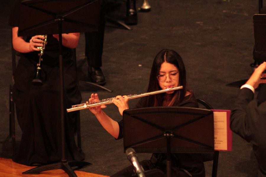 "Karen Cascante ('23) performing her flute solo in ""Selections from The Greatest Showman"" arranged by Murtha. She is the flute section leader of the wind ensemble."