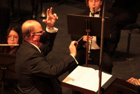 """Dr. Owen Bradley conducting """"Selections from the Greatest Showman"""" arranged by Murtha performed by the wind ensemble."""