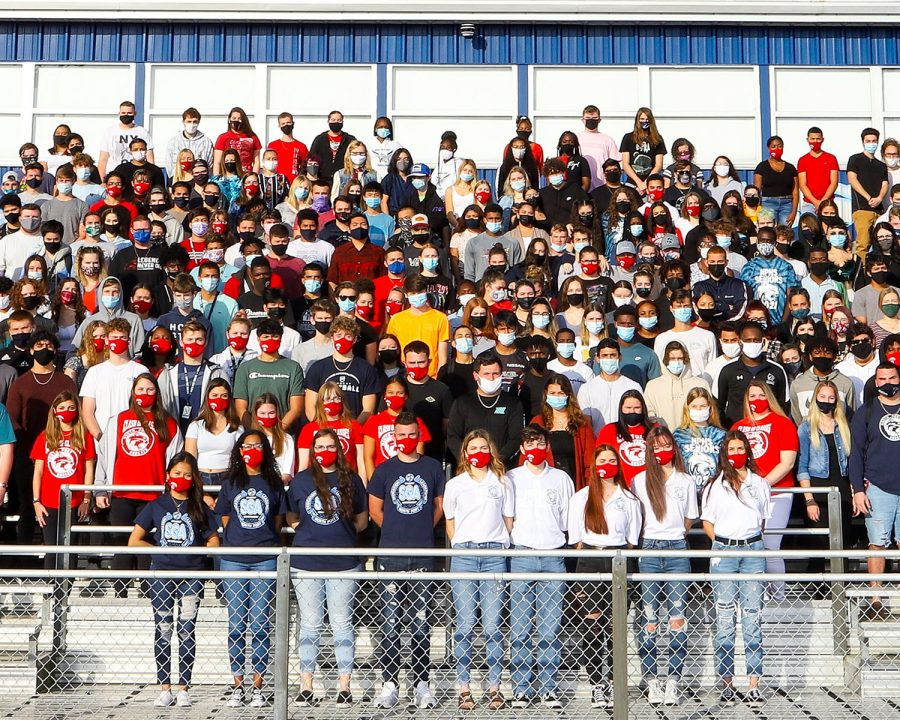 Members of Class of 2021 pose at the Football Bleachers