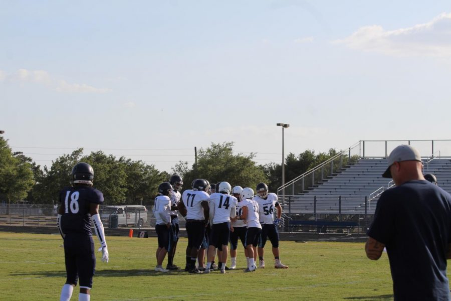 At the recent Blue vs. Silver game at North Port High School taking place on May 21st, 2021, the silver team huddles as quarterback Evan Burger goes over the plays.  Freshmen Evan Burger says, Treat your best things close, you dont know when theyll go away. Evan inspired a lot of his teammates as he was team captain of the JV football team last fall.