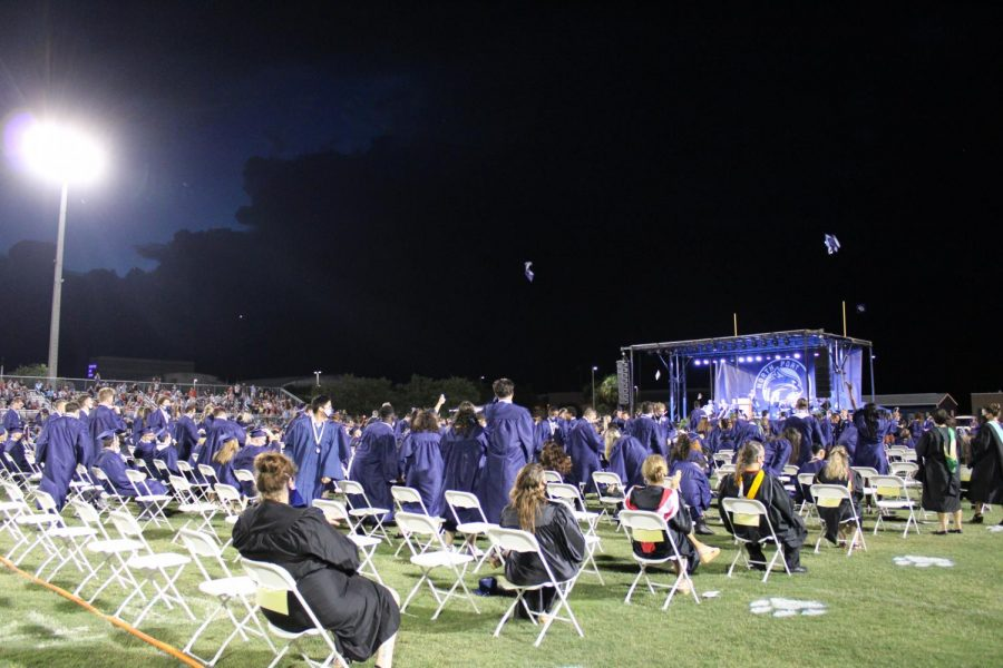 The Class of 2021 standing to leave at the conclusion of graduation.