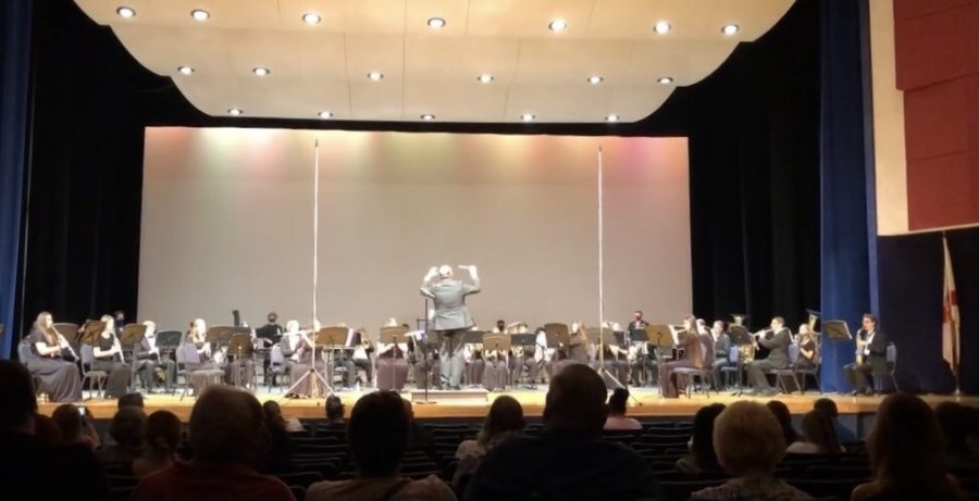 Photo of the stage with musicians and Dr. Bradley conducting.