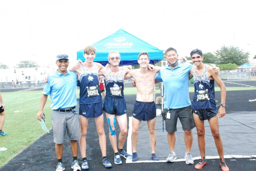 North Port runners and their coaches smile after taking home a #1 victory at their 74 team meet.